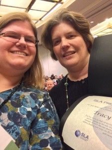 Tracy Maleeff (left) receives a Presidential Citation from 2014 SLA President Kate Arnold.