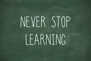 Never stop learning handwritten on blackboard