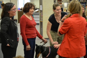 Catherine (left) and some University of Wisconsin-La Crosse students enjoy a visit from a therapy dog, courtesy of the local Humane Society. The dogs visit during finals week to help relieve students' stress.