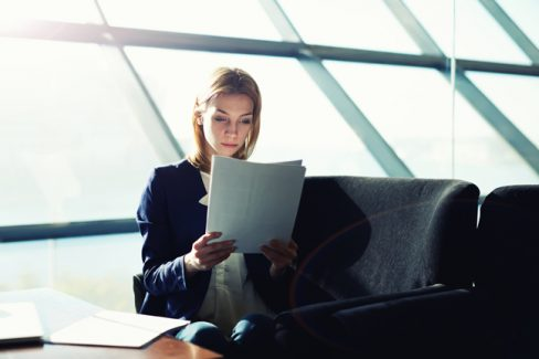 Portrait of a young business lady sitting by their computers and