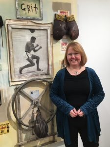 Dee in front of Ali display