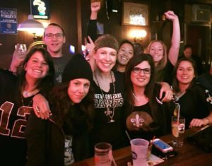 Stacie (in glasses) and fellow fans of the New Orleans Saints watch a game at a bar on the Lower East Side of New York.